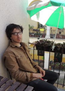 Joseph Pentangelo sitting on a balcony